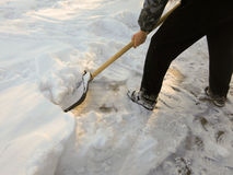 Removing snow with a shovel after snowfall Royalty Free Stock Photography