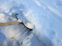 Removing snow with a shovel after snowfall Stock Images