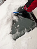 Removing snow from windscreen Stock Photography