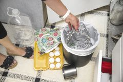 Removing Unwanted Items. A housewife removing unwanted items into a rubbish bin, indoor closeup photo Royalty Free Stock Photography