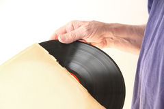 Removing vinyl record from sleeve Stock Photography