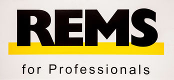 Rems logo. Sticker black letters on the white wall Royalty Free Stock Images
