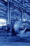 Remsa och mekanisk utrustning i en fabrik Arkivbild