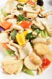 Remuez le calmar frit, escargot d'eau douce avec des légumes images libres de droits