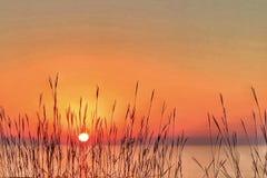 Ren Michigan solnedgång som förbiser Lake Michigan arkivfoton