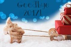 Ren mit Schlitten, blauer Hintergrund, Text Auf Wiedersehen 2017 Lizenzfreie Stockfotos