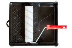 Ren rulle i ett svart plast- magasin Arkivbilder