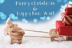 Ren, Schlitten, hellblauer Hintergrund, simsen frohe Weihnachten, neues Jahr Stockbilder