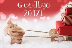 Rena com trenó, fundo vermelho, texto adeus 2017 Fotos de Stock