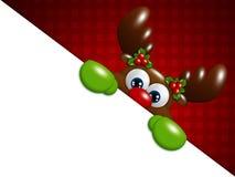 Rena dos desenhos animados do Natal sobre o fundo vermelho que guarda a placa Foto de Stock