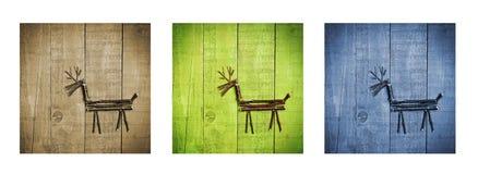 Rena feita das varas no fundo de madeira Tríptico no marrom, no verde e no azul Fotos de Stock