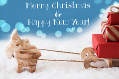 Rena, trenó, luz - fundo azul, Feliz Natal do texto, ano novo Imagens de Stock