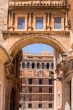 A renaissance arch in Valencia, Spain. A renaissance arch that  leads from the  Lady of the Abandoned Basilica on Plaza de la Virgen to Valencia cathedral. Spain Stock Images