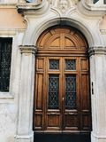 The doors of the old house in Verona. Vertical frame stock photo
