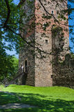 Renaissance Castle Tower. Castle Tower and the remains of the renaissance castle walls surrounded by trees. Sunny weather in June. Country: Poland, Place: Chudow Royalty Free Stock Photo