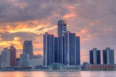 Renaissance Center In Detroit, Michigan At Sunset. The setting sun lights up the clouds behind the skyline of downtown Detroit, Michigan. The spectacle is stock photos