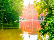 Renaissance chateau Cervena Lhota in Southern Bohemia, Czech Republic. Idyllic and picturesque fairy tale castle on the. Small island reflected in the romantic stock photo