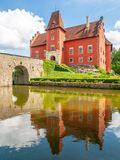 Renaissance chateau Cervena Lhota in Southern Bohemia, Czech Republic. Idyllic and picturesque fairy tale castle on the. Small island reflected in the romantic stock images