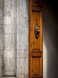 Renaissance Doorway in Florence. A Renaissance era Walnut door with lion's head knocker flanked by a marble Doric column Royalty Free Stock Image