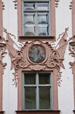 Renaissance facade with stucco decorations and religious paintin Royalty Free Stock Images