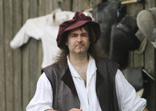 Renaissance Fair man in costume with hat Stock Photography