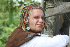 Renaissance Fair man in costume winking Royalty Free Stock Photography