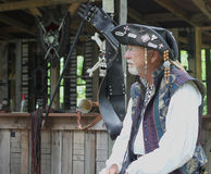 Renaissance Fair man in leather hat and costume Stock Images