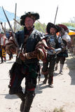 Renaissance Fair parade swordsmen Stock Image
