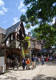 Renaissance Fair. People walking in front of a Bavarian style building in the marketplace at the Bristol Renaissance Faire in Wisconsin Royalty Free Stock Image