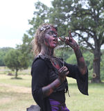 Renaissance Fair woman in costume with evil theme Stock Image