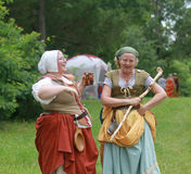 Renaissance Fair women in costume laughing Royalty Free Stock Image