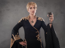Renaissance fashion woman holding goblet with wine royalty free stock photography