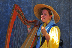 Renaissance fayre musician playing the Harp. Stock Image