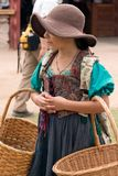 Renaissance Festival Kid. A young girl welcomes visitors to the Arizona Renaissance Festival Royalty Free Stock Photo
