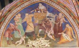 Fresco in San Gimignano - Massacre of the Innocents. Renaissance Fresco depicting the Massacre of the Innocents in the Collegiata of San Gimignano, Italy Royalty Free Stock Photo