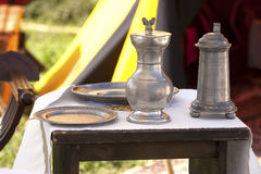 Renaissance furnishings in the military camp. Italy: Renaissance furnishings in the military camp. Flasks, dishes, pots made of metal, silver or pewter Royalty Free Stock Image