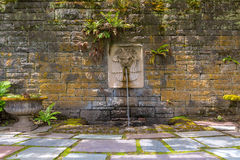 Renaissance Garden with Lion Head Water Fountain Stock Photo