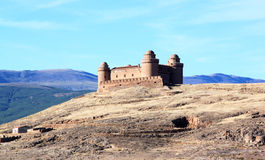 Renaissance haunting Castle of Calahorra, Spain. Looming over the village of La Calahorra and the plateau of the Marquesado in the northern foothills of the Stock Images