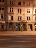 Renaissance house in prague with a nice fasade at night. With a tram line stock image