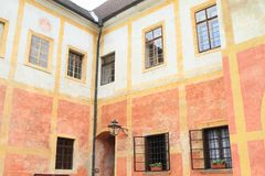 Renaissance house in Zlata koruna. Renaissance house with red and yellow painted plaster in Monastery Zlata koruna, Czech Republic Stock Photos