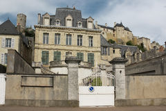 Renaissance Mansions and fortress. Chinon. France. Typical Renaissance Mansions along Quai Charles VII street and the medieval fortress in the background. Chinon Royalty Free Stock Images