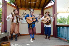 Renaissance Musician Trio. Two guitar playing musicians and a violin player serenade the audience at a performance during the Bristol Renaissance Faire Royalty Free Stock Photography