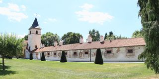 Renaissance outbuildings with Virgin Mary`s Church on palace Kratochvile. Renaissance outbuildings with decoration on plaster and Virgin Mary`s Church with tower stock photo