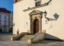 Renaissance portal of town hall of old town in Tarnow, Poland. Latin inscription over the door & x27;Let God protect thy entrance and exit& x27 Royalty Free Stock Photo