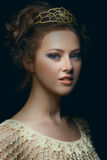 Renaissance portrait. Picturesque portrait of majestic young woman with blue eyes in low key Stock Images