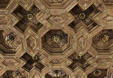 Renaissance Style Coffered Ceiling. An ornate gilt and faux-bois Renaissance style ceiling treatment in Bologna, Italy royalty free stock photos