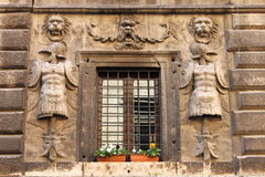 Renaissance window with flower pots Royalty Free Stock Photo
