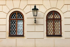 Renaissance windows with iron street lamp Royalty Free Stock Image