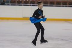 Renata Domash de Bielorrússia executa o programa de patinagem livre das meninas de bronze da classe IV Imagem de Stock