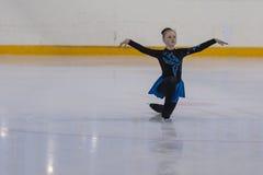 Renata Domash du Belarus exécute le programme de patinage gratuit de filles en bronze de la classe IV Image libre de droits